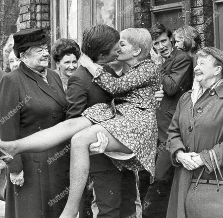 Television Programme: Coronation Street. Dennis Tanner (played By Philip Lowrie) Kisses His Bride Jenny Sutton (played By Actress Mitzi Rogers). Violet Carson (who Plays Ena Sharples Is Pictured Left) And William Roach (who Plays Ken Barlow) Is Pictured 2nd Right.