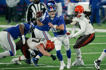 New York Giants quarterback Colt McCoy (12) throws a pass during the first half of an NFL football game against the Cleveland Browns, in East Rutherford, N.J