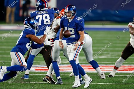 New York Giants quarterback Colt McCoy (12) flips the ball to wide receiver Sterling Shepard (87) during an NFL football game against the Cleveland Browns, in East Rutherford, N.J