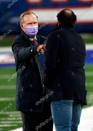 Stock Photo of New York Giants owner John Mara fist bumps Cleveland Browns executive vice president JW Johnson before an NFL football game, in East Rutherford, N.J