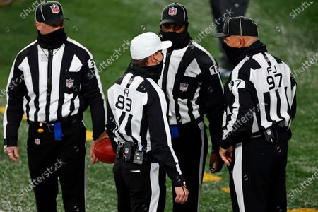 Referee Shawn Hochuli (83) talks with field judge Tom Hill (97) during an NFL football game between the Cleveland Browns and the New York Giants, in East Rutherford, N.J
