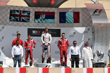 (L to R): Second placed James Nash (GBR) Lukoil Craft-Bamboo Racing SEAT Leon TCR, race winner Dusan Borkovic (MAL) and thrid placed Hugo Valente (FRA) Lukoil Craft-Bamboo Racing SEAT Leon TCR on the podium at TCR International Series, Race Two, Bahrain International Circuit, Sakhir, Bahrain, 16 April 2017.