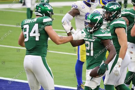 New York Jets running back Frank Gore gets a high five after scoring his 100th rushing touchdown during an National Football League (NFL) game against the Los Angeles Rams at SoFi Stadium in Inglewood, California, USA, 20 December 2020.