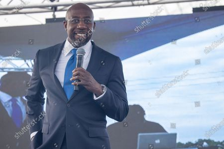 Democratic Senate Candidate Raphael Warnock speaks at a rally targeting Latinx voters
