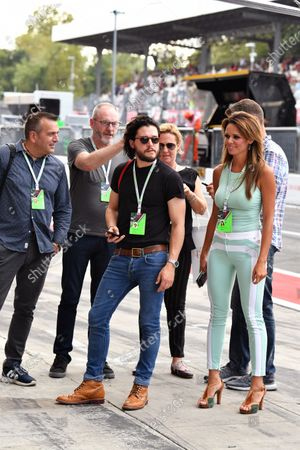Stock Picture of Liam Cunningham (IRL) Actor, Kit Harington (GBR) Actor, Alejandra Gutierrez (VEN) Actress & Model with Ted Dobrzynski (CDN) viagp.com and Stefano Zuech (ITA) Motorsport Consultant at Formula One World Championship, Rd13, Italian Grand Prix, Practice, Monza, Italy, Friday 1 September 2017.