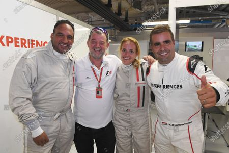 Stock Photo of F1 Experiences 2-Seater passenger Michael Caines (GBR) Chef, Paul Stoddart (AUS), F1 Experiences 2-Seater passenger and Zsolt Baumgartner (HUN) F1 Experiences 2-Seater driver at Formula One World Championship, Rd13, Italian Grand Prix, Practice, Monza, Italy, Friday 1 September 2017.