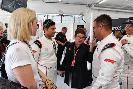 Stock Picture of F1 Experiences 2-Seater passenger with Kate Beavan (GBR) FOM  and Zsolt Baumgartner (HUN) F1 Experiences 2-Seater driver at Formula One World Championship, Rd5, Spanish Grand Prix, Qualifying, Barcelona, Spain, Saturday 12 May 2018.