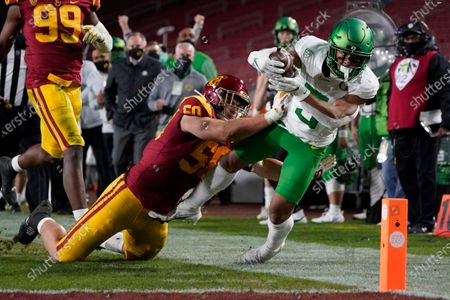 Southern California defensive lineman Nick Figueroa (50) pushes Oregon wide receiver Johnny Johnson III (3) out of bounds during the second half of an NCAA college football game for the Pac-12 Conference championship, in Los Angeles
