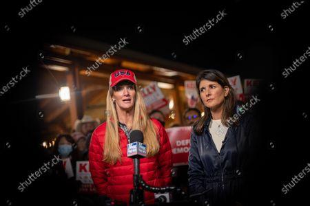 Former UN Ambassador Nikki Haley and Senator Kelly Loeffler talk to media during a press conference after a rally for Senator Loeffler and Senator Perdue