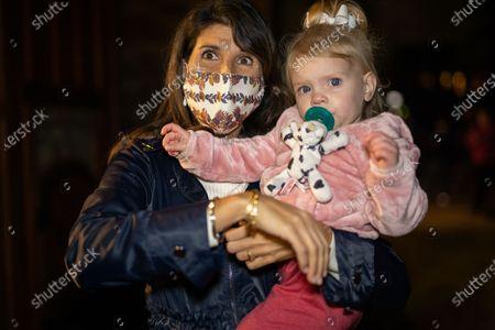 Former UN Ambassador Nikki Haley plays with a child, a family member, after a rally for Senator Loeffler and Senator Perdue