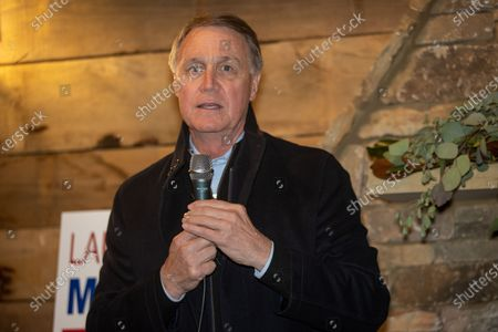 Senator David Perdue speaks at a rally for himself and Senator Kelly Loeffler