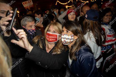 Former UN Ambassador Nikki Haley greets supporters after a rally for Senators Kelly Loeffler and David Perdue