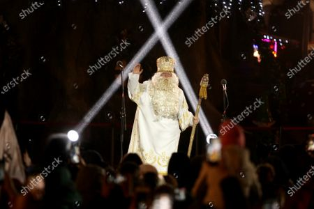 An actor representing Saint Nicholas is seen on stage during the lighting of the country's main Christmas tree in Sofiiska Square on Saint Nicholas Day, Kyiv, capital of Ukraine.
