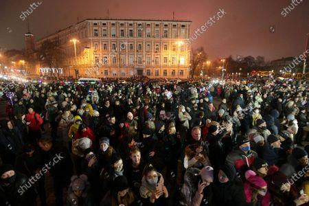People flood Sofiiska Square where the lighting of the country's main Christmas tree is due to take place on Saint Nicholas Day, Kyiv, capital of Ukraine.