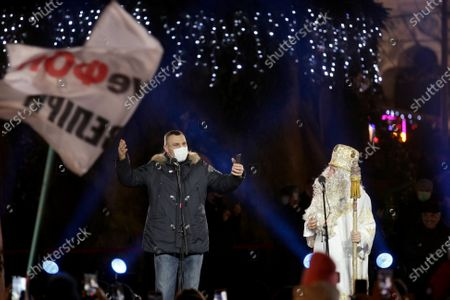 Kyiv city head, Kyiv City State Administration head Vitali Klitschko (L) and an actor representing Saint Nicholas are seen on stage during the lighting of the country's main Christmas tree in Sofiiska Square on Saint Nicholas Day, Kyiv, capital of Ukraine.