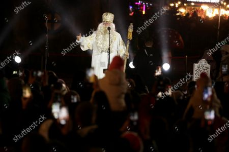 Stock Picture of An actor representing Saint Nicholas is seen on stage during the lighting of the country's main Christmas tree in Sofiiska Square on Saint Nicholas Day, Kyiv, capital of Ukraine.