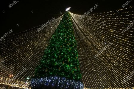 String lights spread out from the country's main Christmas tree in Sofiiska Square on Saint Nicholas Day, Kyiv, capital of Ukraine.