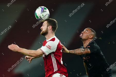 Shkodran Mustafi of Arsenal heads the ball while under pressure from Gabriel Jesus of Manchester City