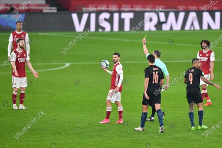 Shkodran Mustafi of Arsenal receives a yellow card for a foul on Gabriel Jesus of Manchester City