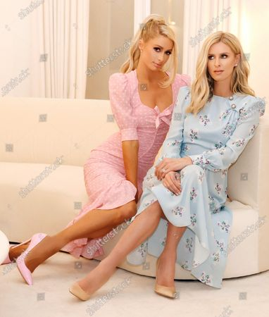 Stock Image of Exclusive - Paris Hilton and Nicky Hilton Rothschild wearing Alessandra Rich