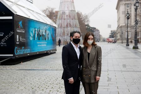 Venezuelan maestro Gustavo Dudamel (L) and Spanish actress Maria Valverde (R) pose for the photographers during the launching of project 'Symphony' outside the Royal Opera House in Madrid, Spain, 21 December 2020. The project is an immersive experience to take classic music closer to all audiences allowing the spectator is one other musician inside the orchestra.