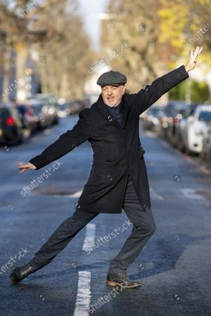 No wonder Bill Bailey feels like jumping for joy. For the 55-year-old comedian has just been crowned the winner of this year's Strictly Come Dancing, becoming the oldest celebrity to lift the glitterball trophy since the show began in 2004. On the frosty morning after the stardust of the night before, Bill pulled on a nice warm coat to show off a few champion moves outside his west London home. Look at his superior hand shaping! No wonder Strictly judge Craig Revel Horwood described it as 'absolutely extraordinary'. Check out the foot placement on that glissade! All part of the process hostess Tess Daly aptly called the 'Strictly-fication of Bill Bailey'. The twinkle-toed star was also reunited with wife Kristin, with the couple, masked, serving up mince pies and hot drinks for the waiting photographers.