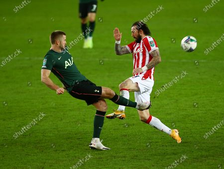 Eric Dier of Tottenham Hotspur and Steven Fletcher of Stoke City