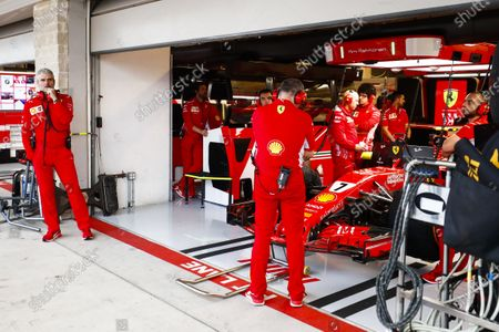 Maurizio Arrivabene, Team Principal, Ferrari, outside the garage where mechanics gather around the car of Kimi Raikkonen, Ferrari SF71H