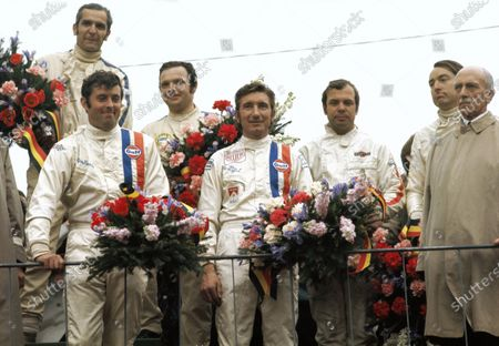 Winners Brian Redman and Jo Siffert stand on the podium together with P3.0 class winners Rudi Lins and Gérard Larrousse and S2.0 class winners John L'Amie and Brian Nelson.