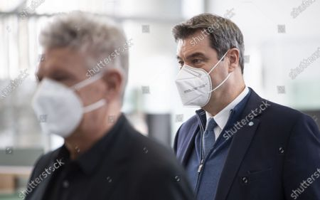 Bavarian Prime Minister Markus Soeder (R) and Munich's mayor Dieter Reiter (R) during a visit of the Corona Vaccination Center in Munich, Bavaria, Germany, 21 December 2020. Centers for mass vaccination against the coronavirus SARS CoV-2 are now being established throughout Germany.
