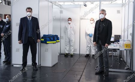 Bavarian Prime Minister Markus Soeder (2-L) and Munich's mayor Dieter Reiter (R) pose during a visit of the Corona Vaccination Center in Munich, Bavaria, Germany, 21 December 2020. Centers for mass vaccination against the coronavirus SARS CoV-2 are now being established throughout Germany.