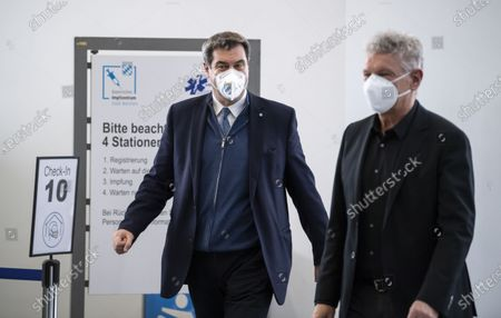 Stock Photo of Bavarian Prime Minister Markus Soeder (L) and Munich's mayor Dieter Reiter (R) during a visit of the Corona Vaccination Center in Munich, Bavaria, Germany, 21 December 2020. Centers for mass vaccination against the coronavirus SARS CoV-2 are now being established throughout Germany.