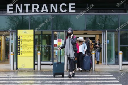 Arriving home for Christmas, people arrive this morning at George Best Belfast city airport before the new restrictions begin.The Stormont Executive agreed that Christmas bubbles in NI should be limited to one day.