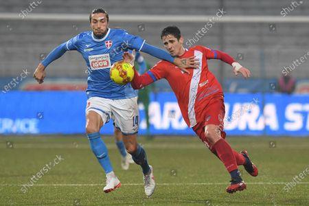 Marco  Migliorini (#14 Novara) and Sean Parker (#9 Aurora Pro Patria)