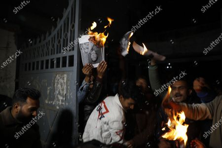 Protesters burn images showing Nepalese President Bidhya Devi Bhandari and Prime Minister KP Sharma Oli during a protest in Kathmandu, Nepal, 21 December 2020. The security has been more strict since many protest erupted across the nation over the dissolution of the house of representatives. Nepalese Prime Minister K.P. Sharma Oli, in response to challenges from party rivals, recommended the dissolution of the Parliament and called for general election during an emergency Cabinet meeting on 20 December. The decision has been ratified by President Bidhya Devi Bhandari, who has called a two-phase election to be held in April and May 2021.