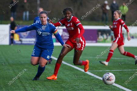 Sarah Wilson (#5 Durham) dribbles away from Rinsola Babajide (#10 Liverpool)