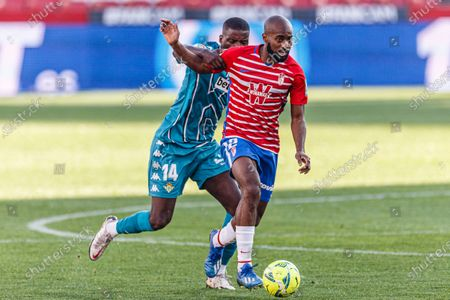 Stock Image of Dimitri Foulquier of Granada (R) fights for the ball with William de Carvalho of Real Betis (L)