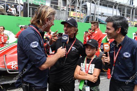 Emerson Fittipaldi talks with Juan Fossalori, Fox Sports on the grid