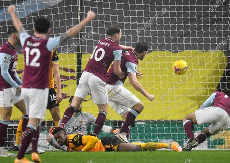 Stock Photo of Wolverhampton Wanderers' Raul Jimenez, centre, celebrates with teammates after scoring his side's second goal during the English Premier League soccer match between Burnley and Wolverhampton Wanderers at the Turf Moor stadium in Burnley, England