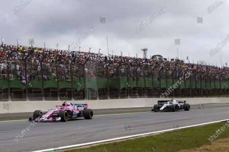 Esteban Ocon, Racing Point Force India VJM11 and Lance Stroll, Williams FW41