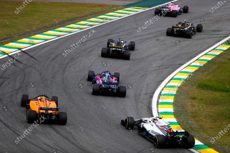Sergio Perez, Racing Point Force India VJM11, leads Carlos Sainz Jr., Renault Sport F1 Team R.S. 18, Nico Hulkenberg, Renault Sport F1 Team R.S. 18, Brendon Hartley, Toro Rosso STR13, Fernando Alonso, McLaren MCL33, and Sergey Sirotkin, Williams FW41