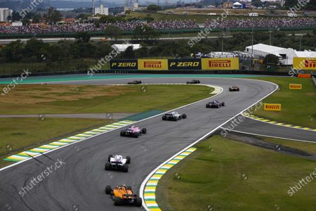 Brendon Hartley, Toro Rosso STR13, leads Sergey Sirotkin, Williams FW41, Esteban Ocon, Racing Point Force India VJM11, Lance Stroll, Williams FW41, and Stoffel Vandoorne, McLaren MCL33