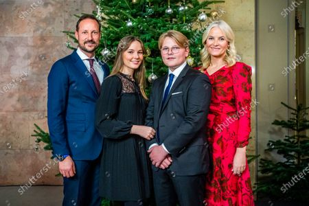 Stock Photo of The Norwegian royal family, (L-R) Crown Prince Haakon, Princess Ingrid Alexandra, Prince Sverre Magnus, and Crown Princess Mette-Marit, pose for Christmas photographs at the Royal Palace in Oslo, Norway, 15 December 2020 (issued 21 December 2020).
