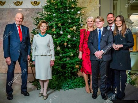 The Norwegian royal family, (L-R) King Harald and Queen Sonja, one meter away from Crown Princess Mette-Marit, Prince Sverre Magnus, Crown Prince Haakon, and Princess Ingrid Alexandra, pose for Christmas photographs at the Royal Palace in Oslo, Norway, 15 December 2020 (issued 21 December 2020).