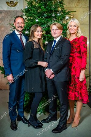 The Norwegian royal family, (L-R) Crown Prince Haakon, Princess Ingrid Alexandra, Prince Sverre Magnus, and Crown Princess Mette-Marit, pose for Christmas photographs at the Royal Palace in Oslo, Norway, 15 December 2020 (issued 21 December 2020).