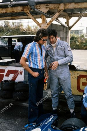 Jody Scheckter talks with Barry Sheene in the pitlane.