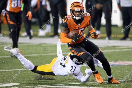 Cincinnati Bengals wide receiver Tee Higgins (85) runs the ball past Pittsburgh Steelers safety Marcus Allen (27) during an NFL football game, in Cincinnati