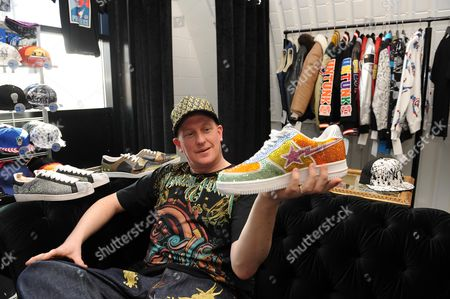 Journalist Colin Young (l)with A3000 Trainers In 'the Pr9ject' Djibril Cisse's Clothes Shop In Newcastle .