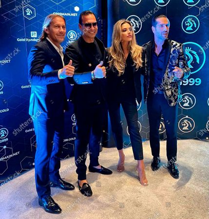 """In this image released, from left, footballer Miguel Salgado, GSB CEO Josip Heit, and Actress Sophia Thomalla pose for a photograph. GSB Gold Standard Group, in compliance with all coronavirus pandemic regulations, held its big """"Good-bye-2020 - Welcome 2021 - Event"""" in Dubai's luxurious Jumeirah Beach district, in the midst of international banks and oil companies. Press release and media available to download from www.apmultimedianewsroom.com. ** HANDOUT IMAGE ** Free to use. Please see Special Instructions field"""