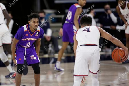 Northwestern State guard CJ Jones (0) defends Gonzaga guard Aaron Cook (4) during the second half of an NCAA college basketball game in Spokane, Wash